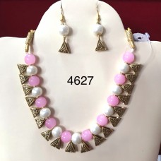 Necklace of Pink And White Pearls Glowing with Brass Triangle