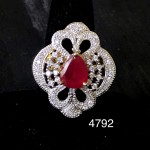 INDIAN WOMEN ENGAGMENT RING IN WHITE AD WITH RUBY SOLITAIRE