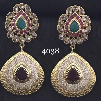 FUSION EARRING IN GOLDEN  ALLOY WITH WHITE AD AND RUBY STONE