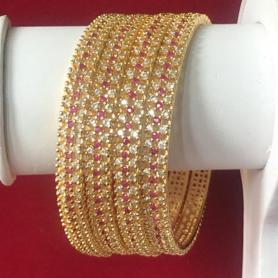 HIGH PROFILE STATEMENT CLASS BANGLE IN RUBY AND WHITE AD WITH GOLDEN POLISH
