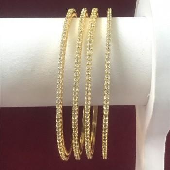 GOLDEN POLISH SLIM BANGLES IN TOP QUALITY AD STONES