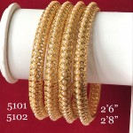 GOLDEN JALI HAND WORK WITH STUDDED PEARLS BANGLES