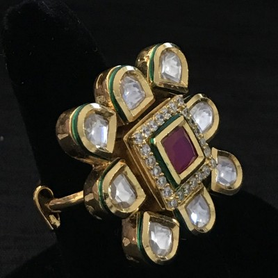 WHITE POLKI IN GOLDEN D SURROUNDING RUBY AND AD SQ RING